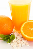 Oranges juice and vitamin c tablets Stock Photos