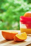 Oranges and juicer Royalty Free Stock Image