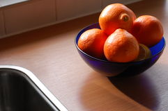 Oranges in the kitchen  Stock Photos