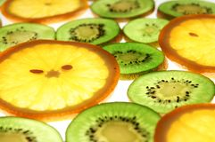Oranges and kiwi slices. Juicy shiny orange and kiwi slices closeup Stock Photo