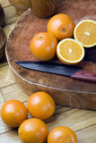 Oranges and knives Stock Image