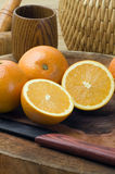 Oranges and knives Royalty Free Stock Photos