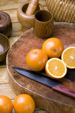 Oranges and knives Royalty Free Stock Images