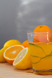 Oranges and lemon with slices and glass of fresh orange juice Royalty Free Stock Image