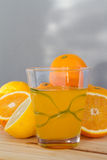Oranges and lemon with slices and glass of fresh orange juice Stock Photography