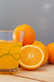 Oranges and lemon with slices and glass of fresh orange juice Royalty Free Stock Photo