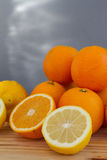 Oranges and lemon with slices Royalty Free Stock Images