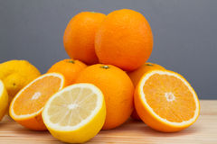 Oranges and lemon with slices Stock Images