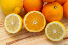 Oranges and lemon with slices Stock Photography