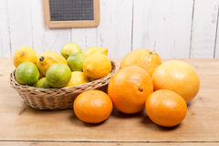 Oranges, lemons and grapefruit presented in a small basket Royalty Free Stock Image
