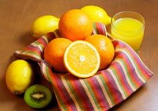 Oranges, lemons, kiwi  and glass of orange juice Royalty Free Stock Photography