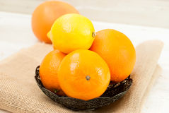 Oranges and lemons pile on the table Stock Photography