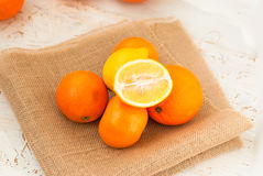 Oranges and lemons pile on the table Stock Photo
