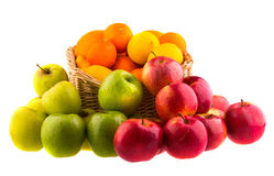 Oranges and lemons, red and green apples in a wooden basket Royalty Free Stock Photography