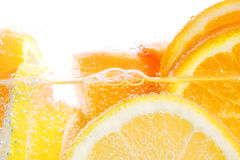 Oranges and lemons in water Stock Photo