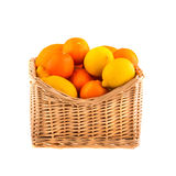 Oranges and lemons in a wooden basket, isolated on white background. Fruit. Stock Images