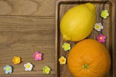 Orange and lemon. Citrus fruits. Orange and lemon. Over wood table background with copy space Royalty Free Stock Photos
