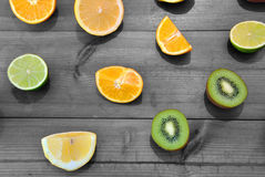 Oranges, limes and kiwis. Cut pieces of oranges, lemons and kiwis stock photo