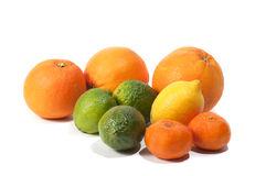 Oranges, limes, tangerines and lemon,  on white Royalty Free Stock Image