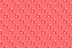 Oranges on a living coral colored background. Repeating pattern, preparation for wallpaper citrus mood. Oranges on living coral colored background. Repeating stock photography