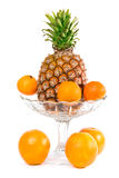 Oranges, mandarin and pineapple in a bowl Royalty Free Stock Photography
