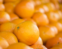 Oranges. Navel oranges stacked at a vegetable market Stock Photos