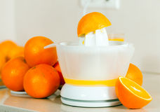 Oranges near the hand juicer Royalty Free Stock Images