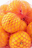 Oranges in a net Stock Images