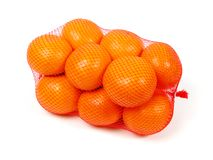 Oranges in net. Over white background Stock Images
