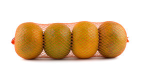 Oranges in net. Isolated on white background Stock Photo