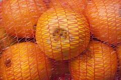 Oranges In A Net Sack Stock Photos