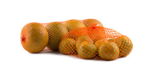 Oranges in net. On white background Stock Image