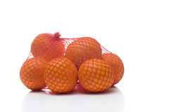 Oranges in netting Stock Images