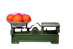 Oranges on old scale Royalty Free Stock Image