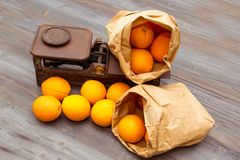 Oranges. In an old weight scale royalty free stock photography