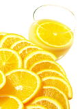 Oranges with orange juice. Slices of oranges with a glass of orange juice on isolated white background royalty free stock photography