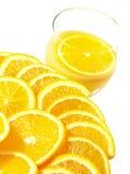 Oranges with orange juice Royalty Free Stock Photography