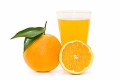 Oranges and orange juice glass Stock Photos