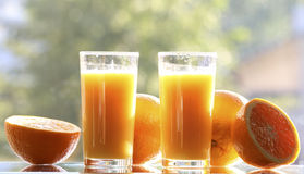 Oranges and orange juice Royalty Free Stock Images
