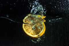Oranges. And lemons in a bowl of water spray stock image