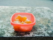 Oranges. Organic fresh oranges in a container on table royalty free stock photo