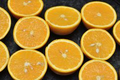 Oranges over black Stock Photography