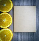 Oranges over Old Woody Background Stock Images