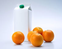 Oranges and packaging Stock Images