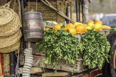 Oranges and parsley on a wagon Stock Photography