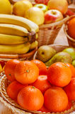 Oranges, pears, bananas and apples Stock Photos