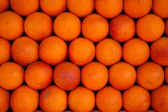 Oranges less perfect. Fresh stacked oranges on a market in Marrakesh, Morocco Stock Photography