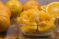 Oranges. Pieces of oranges in a glass bowl Royalty Free Stock Images