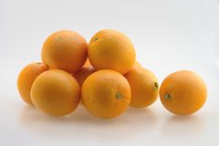 Oranges in a Pile. Fresh oranges in a pile ready to be peeled stock photos