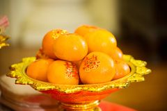 Oranges pile, on gold plated for worship in the Chinese New Year.chinese New Year`s Eve Celebration. Influence of religion on festivals. image for illustration stock images